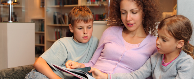 Children reading with an adult