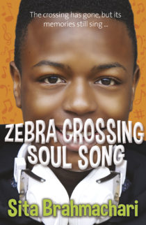 Cover image for Zebra Crossing Soul Song by Sita Brahmachari - An image a young black man smiling and wearing headphones, the words Zebra Crossing Soul Song are displayed in front of him