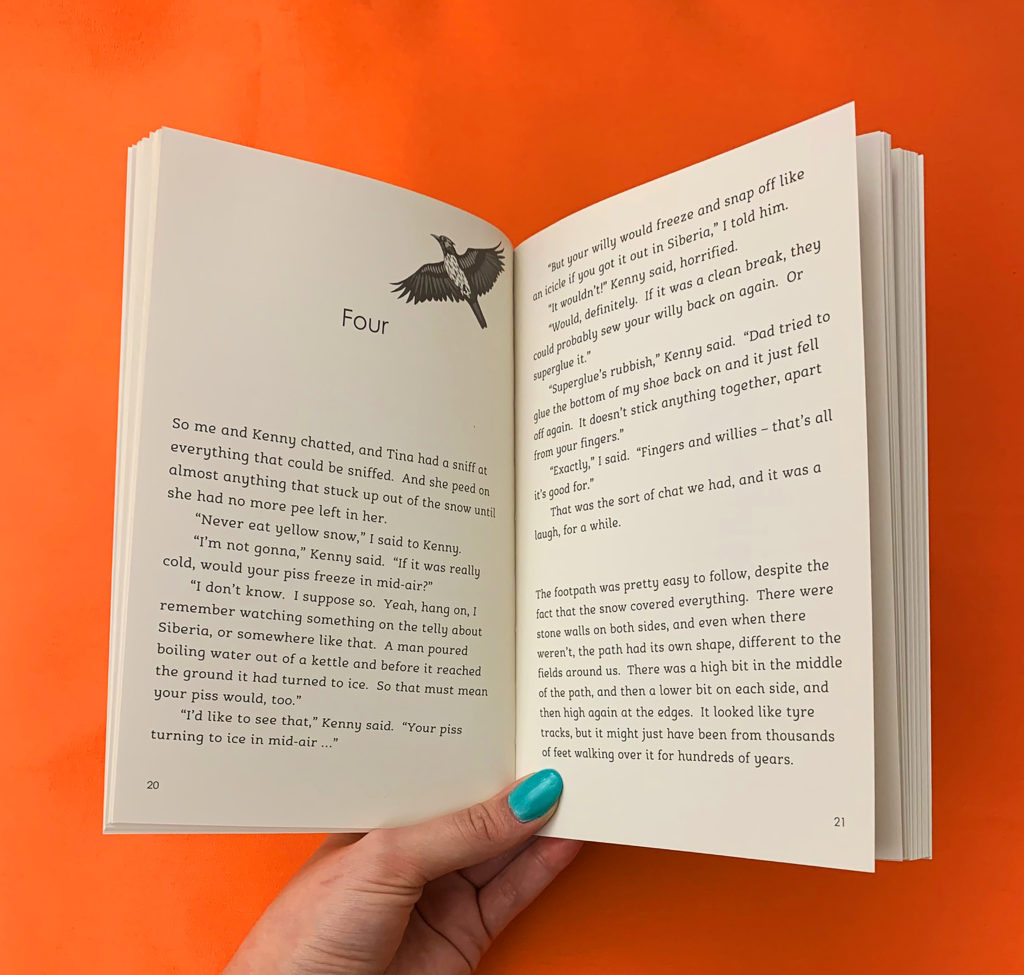 A photograph of chapter four of Lark lying open on an orange table