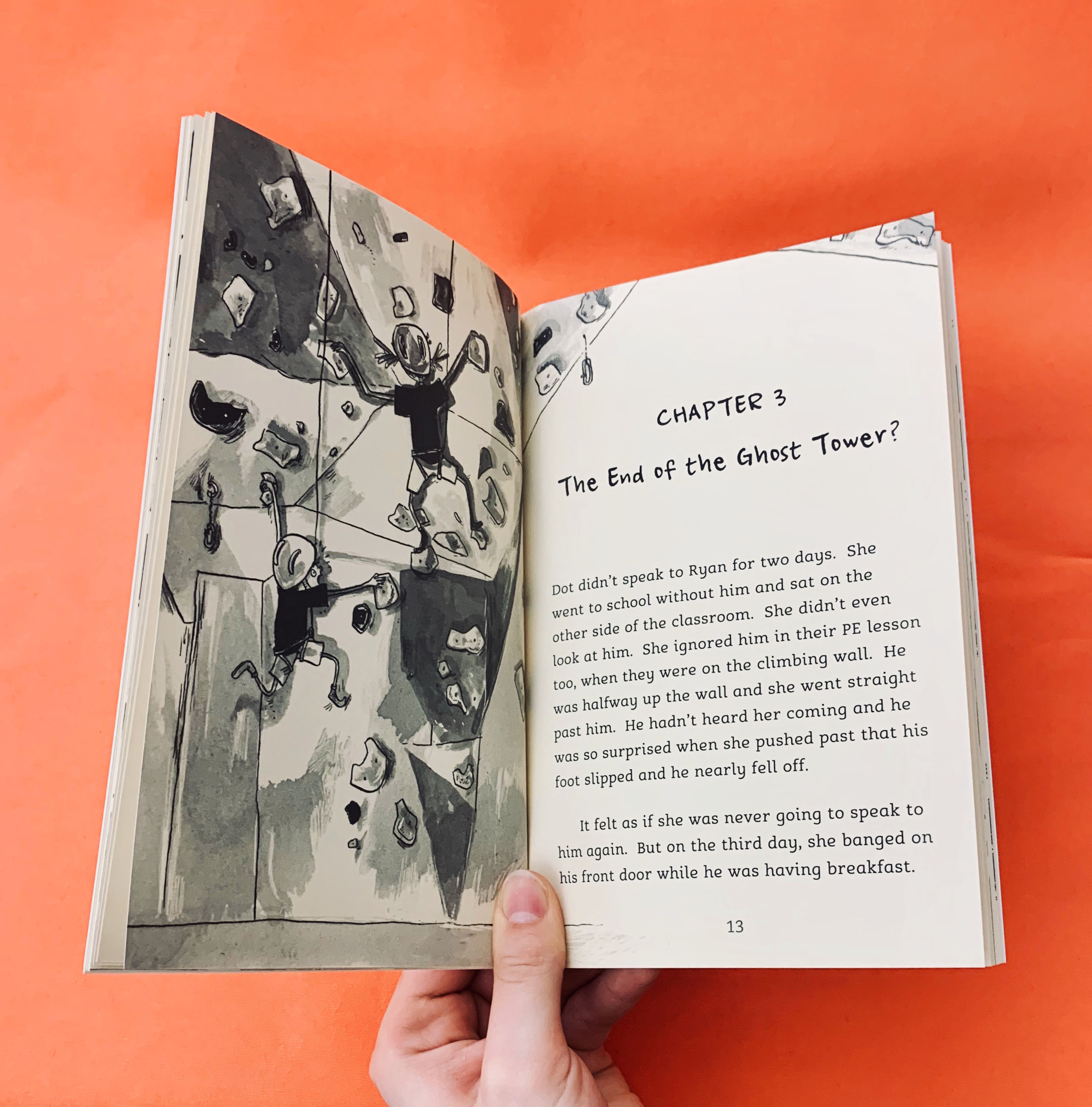 an image of The Ghost Tower opened at a page with an illustration of Dot and Ryan going wall climbing