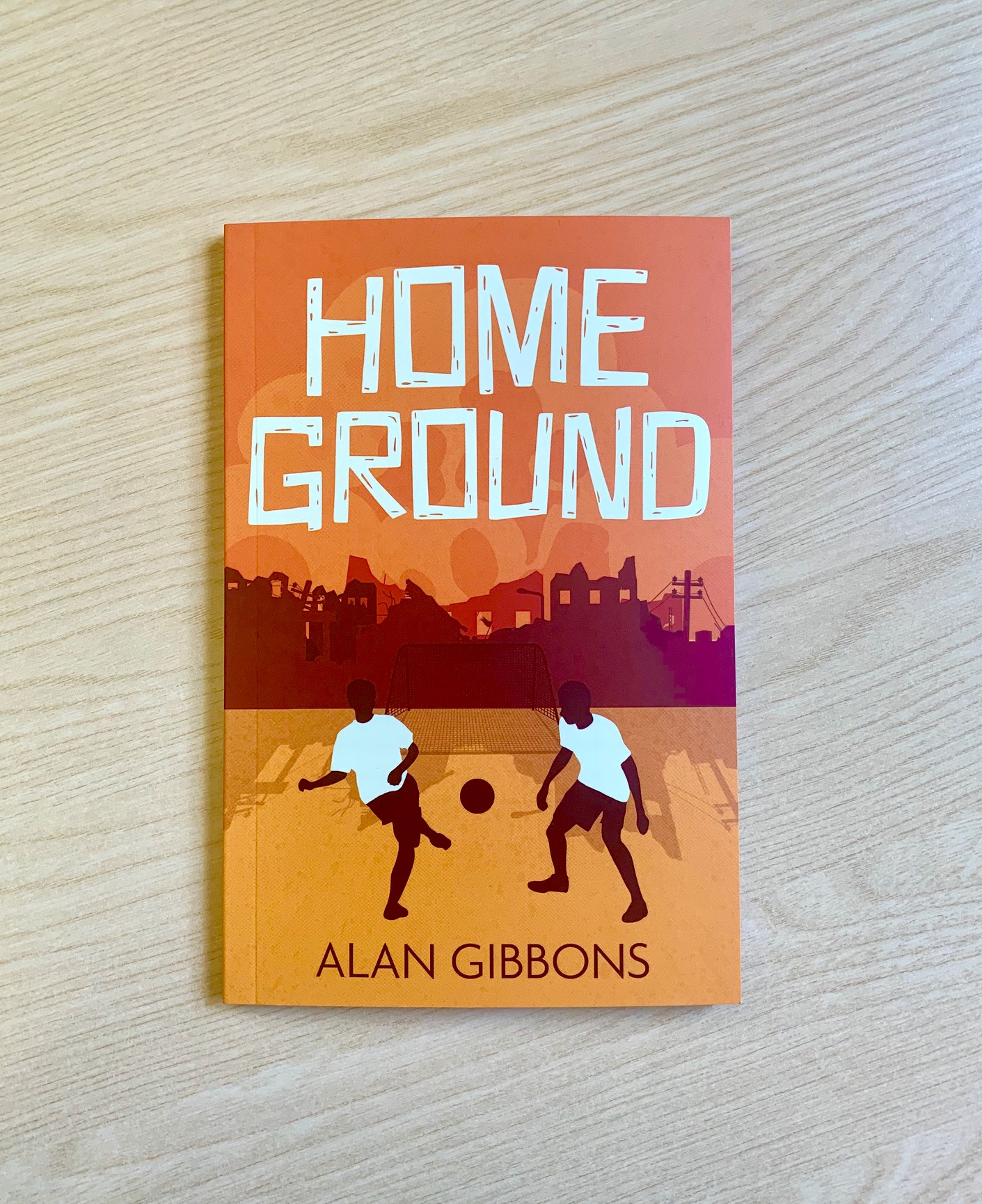 A photograph of the book Home Ground by Alan Gibbons