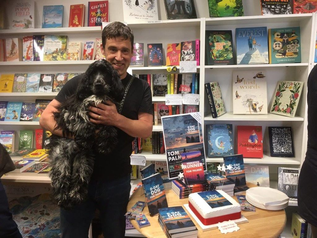 Photograph of author Tom Palmer and his dog Finn at the launch of his book D-Day Dog