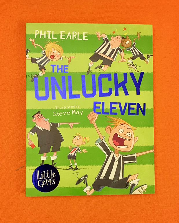 A photograph of a copy of The Unlucky Eleven by Phil Earle