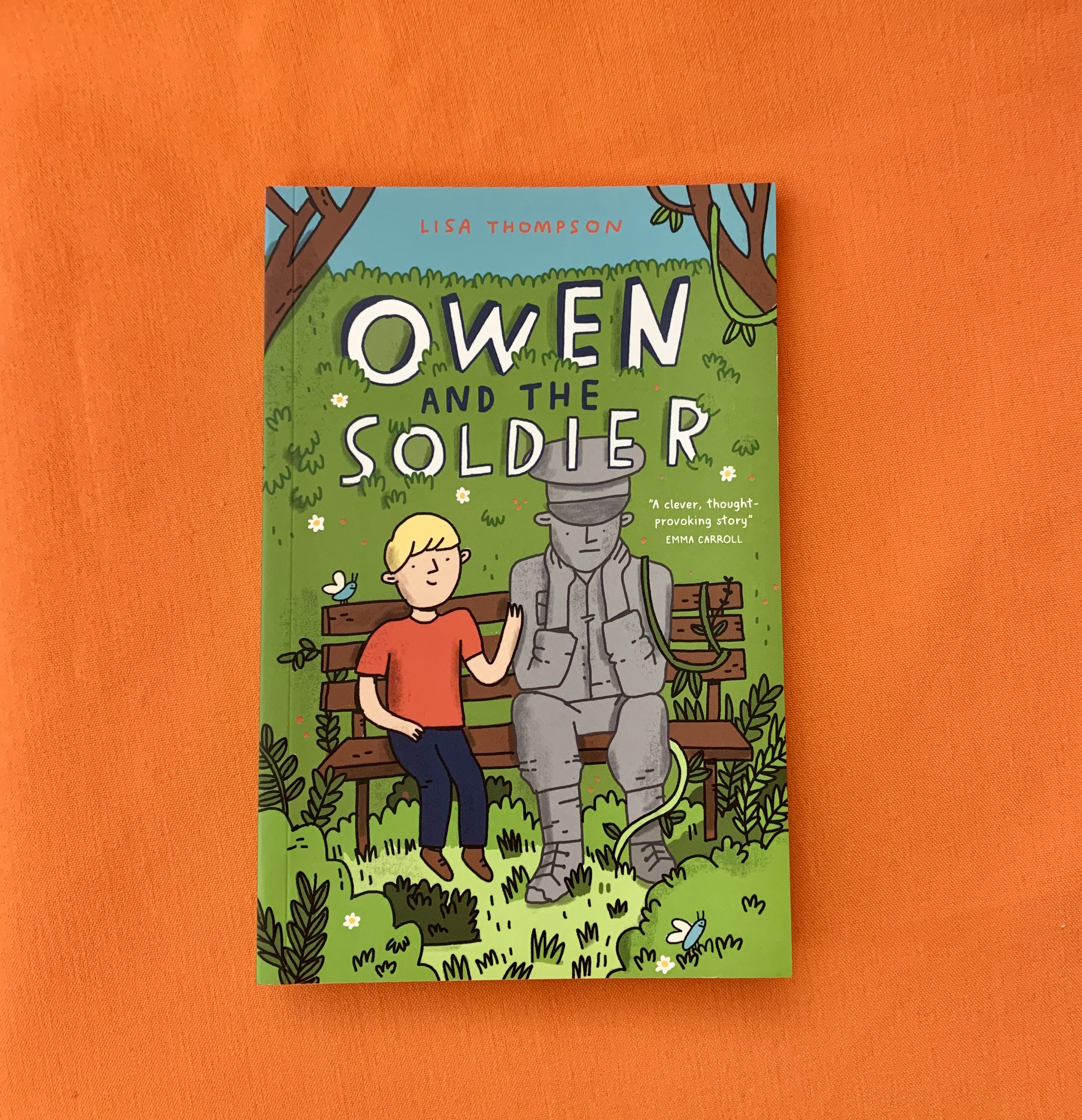 A photograph of Owen and the Soldier on an orange background